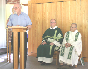 Ivan Kauffman reads lectionary texts at Saturday Eucharist