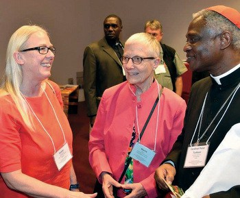Pax Christi International secretary general Greet Vanaerschot and PCI co-president Marie Dennis speak with Cardinal Peter Turkson, president of the Pontifical Council for Justice and Peace, at an April 11-13 conference on nonviolence and just peace in Rome. — Gerry Lee/Maryknoll